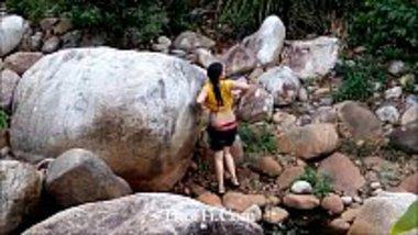 Hot Nepali girl dressing after an outdoor bath