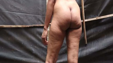 Big ass Tamil girl striptease show in the outdoors