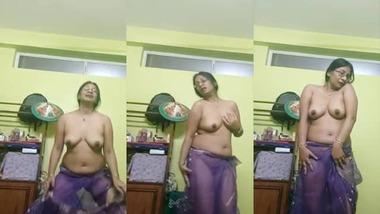 Naughty aunty dancing topless on selfie cam