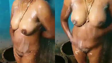 Indian MILF with a little big saggy but still hot tits washes in solo porn